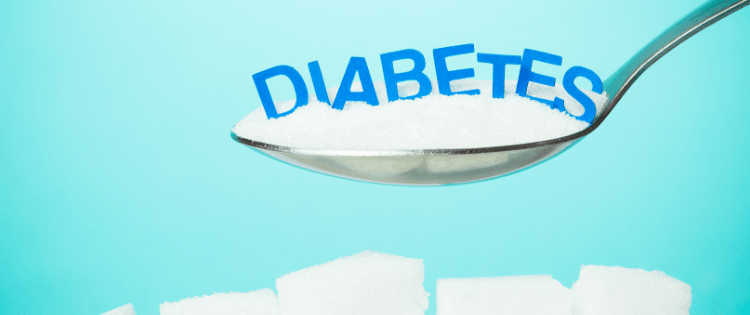 Diabetes, image of a spoon full of sugar with the words diabetes on top