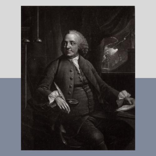 Ben Franklin sitting at desk