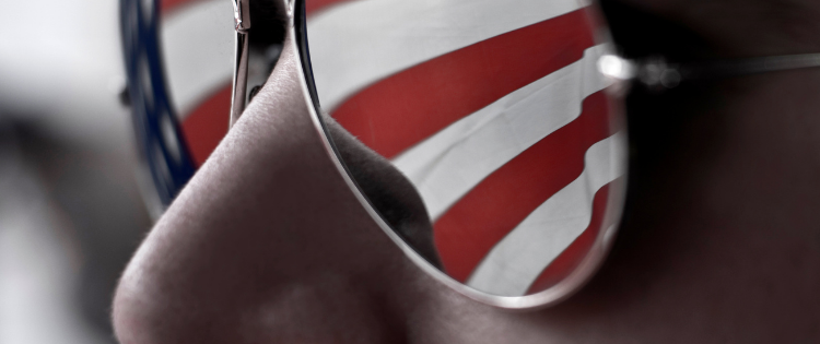 FLAGS REFLECTION IN MAN`S SUNGLASSES